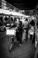 Man with monkey (erikvdlinden) Tags: ifttt 500px amsterdam netherlands adult bw bicycle bike black white candid shot elder funny male man one person puppet street photography toy walking people transportation system monochrome market