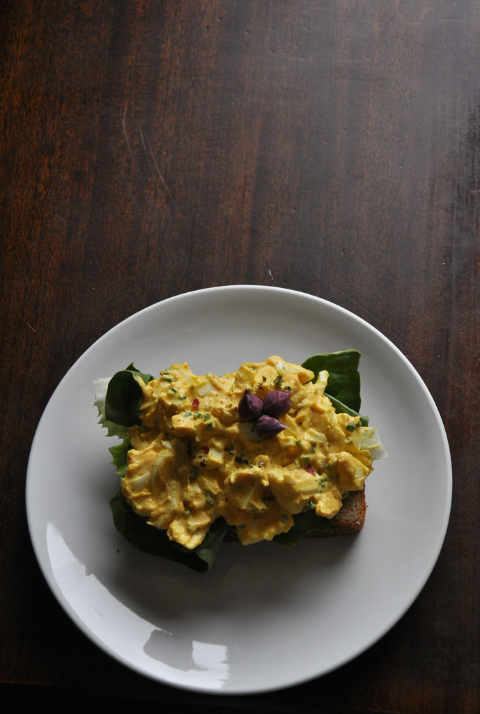 curried egg salad with chive blossoms