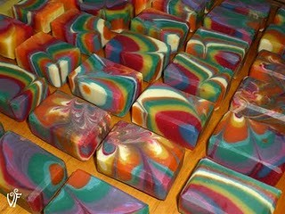 a whole lot of the rainbow column swirl soaps, in many colours and configurations of swirlies.