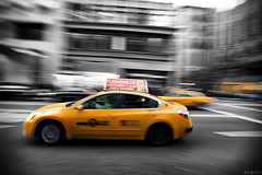 (McHeras) Tags: new york city nyc white ny motion black blur color colour nikon d manhattan district taxi 28 nikkor avenue panning f28 8th av afs partial selective 1735mm garment eighth 1735 ifed d700
