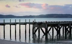 Wharf at Sunset (scinta1) Tags: sunset sea newzealand beach water clouds evening jetty hills auckland wharf ripples maraetai pohutakawacoast