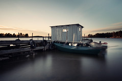 Shed (- David Olsson -) Tags: longexposure sunset lake water boats evening pier nikon sweden jetty shed sigma nopeople tires hut le april 1020mm 1020 motorboat vnern 2012 dx hammar vrmland ndfilter smoothwater skoghall d5000 floatingpier davidolsson nd500 blurredboats lightcraftworkshop vstraskagene 2exposuremanualblend