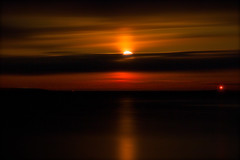 Red Moon Rising (SunnyDazzled) Tags: ocean red sky moon lighthouse seascape reflection nature water night clouds rising lights coast colorful lighthouses glow view horizon maine coastal moonrise frenchmanbay