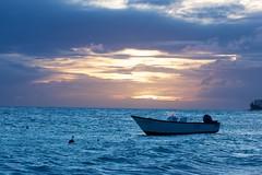 Boat at sunset (AndrwMkngs) Tags: ocean sunset vacation sun holiday beach water boat sand barbados caribbean fishingboat