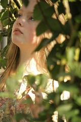 135/366 (Charlotte Catherine) Tags: trees summer portrait plants sun sunlight selfportrait blur green floral leaves self leaf spring blurry shadows warmth highschool trellis exams 365 day133 366 girlshadow 133366 canoneos550d