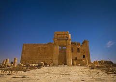 Temple Of Bel In The Ancient Roman city of Palmyra, Syria (Eric Lafforgue) Tags: travel blue color colour history tourism archaeology monument horizontal architecture outdoors temple photography ancient day roman middleeast nopeople unescoworldheritagesite unesco arabic arabia syria column ancientcivilization 414 palmyra thepast palmira siria traditionalculture levant syrien syrie placeofworship sirja tadmor traveldestinations colorimage famousplace suriye   syri buildingexterior oldruin unescoworldheritagelist internationallandmark ancientcivilisation templeofbel mediterraneanculture  sria szria builtstructure  syrianculture westernasia architectureandart   middleeasternculture  suriah sirija  cp  sora circa1stcentury
