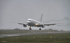 Titan Airways 757-200 Landing at Knock G-POWH (birrlad) Tags: white rain weather airplane airport aircraft aviation airplanes bad landing airline boeing arrival airways approach titan airlines runway landed 757 knock airliner noc arriving 757200 757256 gpowh
