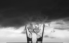 Broken in Bad Weather (danliecheng) Tags: abstract artistic blackandwhite broken clouds cloudy couple cup dark emotion facetoface glass mood parties partner parts relationship repair sky strong weather
