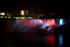 American Falls at Night (Oscar von Bonsdorff) Tags: longexposure blue red white newyork ontario colors beautiful night canon dark studio lights niagarafalls waterfall amazing interesting unitedstates canadian pro northamerica strong searchlight headlight nightphoto bridalveilfalls photographing xsi americanfalls splashing strobelight niagarariver brights canonefs1022mmf3545usm canon1022 superwide niagaraflle chutesniagara niagarafallen canonefs1022 canon1022usm 450d canonefs 1022usm  canonef1855 cascatedelniagara niagaraatnight 10223545 nightphotographing niagarafallsnight cataratasdelnigara  horseshoefallsusa oscarvonbonsdorff