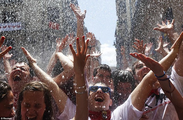 Sun, sangria and a sea of red... as Pamplona prepares for another gorefest at the running of the bulls  5