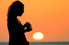 Sunset silhouette (liemazter) Tags: sunset sea portrait orange woman beach backlight canon contraluz atardecer mar mujer colombia retrato makeup playa silouette silueta naranja taganga maquillaje t2i liemazter