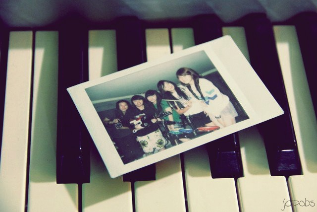 polaroid on piano