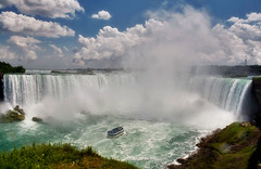 Niagara Falls (Artur Staszewski) Tags: cruise summer sun white ontario canada green fall water clouds canon river boat warm day sunny tourist niagara falls falling foam xs visitors tamron 1224mm foamy attraction visited