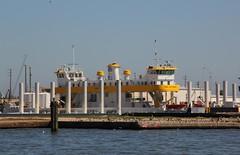 Ferry Awaiting Service in Galveston (Satin Ribbon) Tags: pelicans gulfofmexico water birds docks boats texas gulls ships deck aquaticlife moored galvestonbay dockside ferryboats uscoastguardship