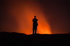 Facing the heat (Thierry Hennet) Tags: africa longexposure red people orange black art texture rock stone night zeiss outdoors fire volcano lava photographer sony crater astronomy ethiopia clearsky magma firelight africanart a900 danakil ertaale cz1635mmf28 africancosmos