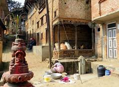nepal (gerben more) Tags: street nepal woman village buddha buddhist streetlife streetscene doorway laundry washing kirtipur