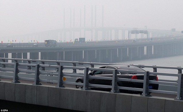 That is a £1bn bridge too far World's longest sea bridge opens to traffic in China... but it will only hold the title for five years  4