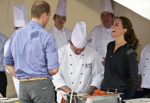 Prince William rules the waves as he beats Duchess of Cambridge in dragon boat race but despite the drizzly day Kate Middleton looks simply 21