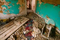 messy bedroom (Sam Scholes) Tags: door old blue red house green abandoned trash digital rural carpet utah bedroom beige decay tan dirty doorway weathered peelingpaint decrepit damaged rubble hiawatha d300 kingcoal usfco unitedstatesfuelcompany