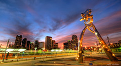 Traveling Man (maconahey) Tags: longexposure sunset sculpture man art colors statue train canon matt dallas long exposure downtown texas colours tx deep sigma dfw traveling 1020mm dart hdr deepellum 2010 clarkson ellum 30d canon30d travelingman skylilne maconahey mattclarkson