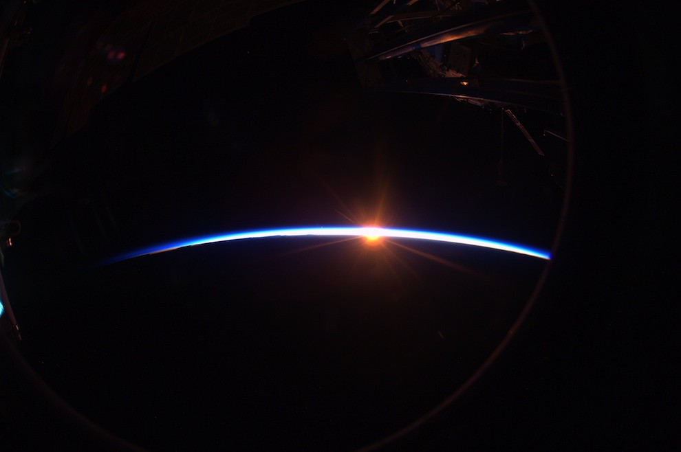 Incredible Photos from Space: Daybreak - sunlight just starting to emerge on horizon behind earth