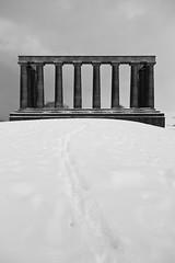 Snowy disgrace (B&W) (Lucky Poet) Tags: winter snow monument scotland edinburgh classical pillars caltonhill