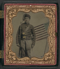 [Unidentified soldier in Union uniform with Zouave fez and bayoneted musket in front of painted backdrop showing American flag] (LOC) (The Library of Congress) Tags: usa soldier flag unitedstatesofamerica union americanflag civilwar libraryofcongress yankee yankees thenorth theunion zouave musket americancivilwar warbetweenthestates uscivilwar zouaves thecivilwar xmlns:dc=httppurlorgdcelements11 dc:identifier=httphdllocgovlocpnpppmsca26893 unionzouave