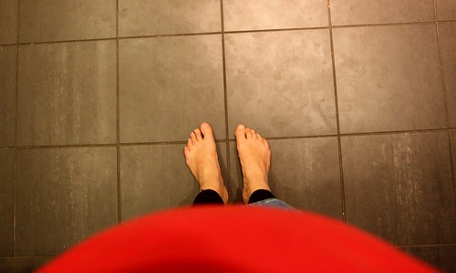 Barefoot and pregnant in the kitchen