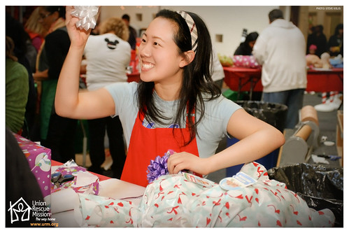 Volunteer wrapping gifts at Christmas Store 2010