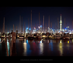 Calm night (Danskie.Dijamco.Photography) Tags: city longexposure sea newzealand sky tower water marina lights boat bright smooth auckland sail raft seashore queenstreet skycitytower