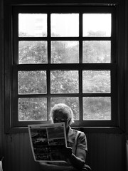 grandmother (Vitor Mateus.) Tags: portrait people bw white black rain reading day grandmother pb expressive