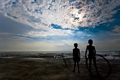 Nature.... (Shad0w_0f_Dark) Tags: boy sea sky urban sun beach water rain clouds boat ray child play land ttl 2009 kuakata potuakhali borishal