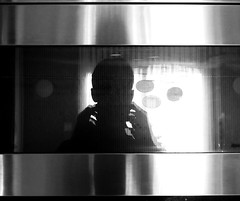Self portrait reflected in the microwave (pilechko) Tags: light shadow portrait blackandwhite bw sun sunlight selfportrait window monochrome silhouette mobile metal silver glare metallic steel