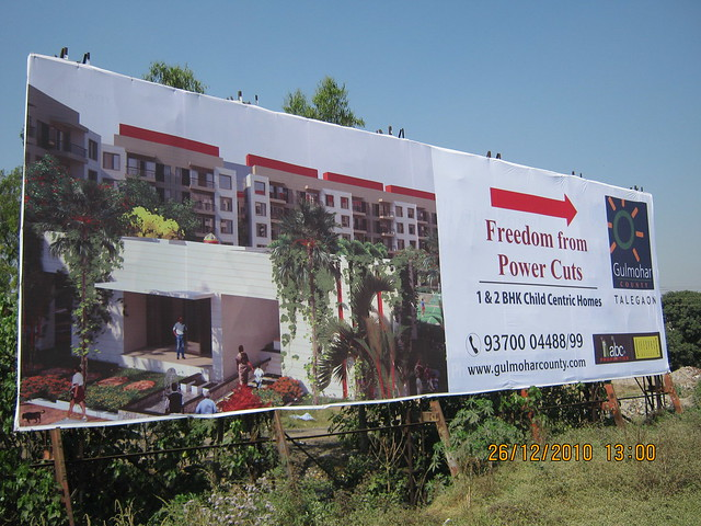 Aggressive promotion of Gulmohar County, 1 BHK & 2 BHK Flats, behind Talegaon Telephone Exchange, Talegaon Dabhade, Pune 410 506 - Hoarding!