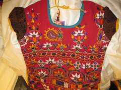 RED KUTCCHI COTTON KURTI (RubyGoes) Tags: new flowers blue red india white green leaves yellow shopping petals purple embroidery delhi peacock blouse ups cotton paisley embroidered nitin gujarat kumar kapil kutchi vipin khadi goel kurti onlineshop mirrorwork freeshipping khaddar jaiho exoticindiacom
