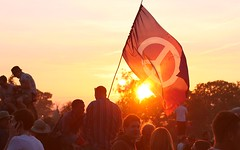 CND Flag waving at sunset - Glastonbury Festival 2010 (bobaliciouslondon) Tags: light sunset people art festival night fire lights haze flag smoke banner glastonbury heat glastonburyfestival waving 2009 stonecircle cnd perfomance pilton worthyfarm campaignfornucleardisarmament glastonbury2009