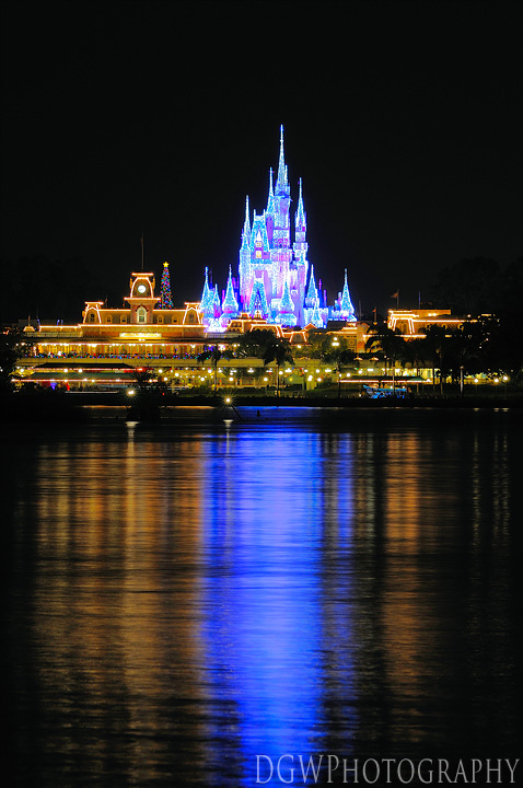 Cinderella's Castle Reflecting Over The Lagoon