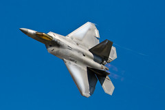 F-22 Raptor Whisper Pass (w4nd3rl0st (InspiredinDesMoines)) Tags: above door summer wallpaper jason hot canon computer fun photography grey whisper unitedstates screensaver outdoor navy pass inspired bluesky tourist airshow bombay stealth f22 dslr usnavy base usn overhead radar highspeed 2010 yf22 jsf jointstrikefighter vaportrail stockphotography airforcebase evading afterburner vorticies offutt offuttafb pulsejetengine stealthfighter bombbaydoors lowspeedpass bestplaces highgturn inspiredphotography pulseengine mrachina wwwinspiredphotographydsmcom whisperpass lowvisibilitygrey w4nd3rl0st