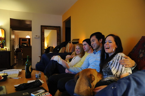 Rosie, the dog, continues to request a seat on the couch, while everyone enjoys the conversation, Dani laughs, watching TV, Wedgwood, Washington, USA