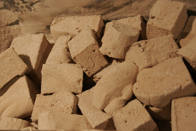 homemade cocoa marshmallows tumbled in a pan