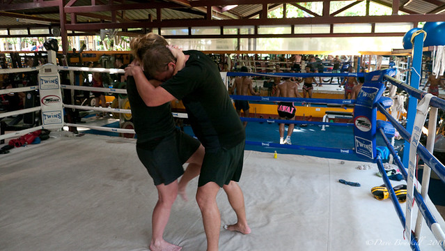 learning to grapple and clinch at Muay Thai camp in Thailand