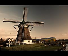 Typical Dutch (Focusje (tammostrijker.photodeck.com)) Tags: holland mill netherlands windmill dutch train ns molen 1722 hazerswouderijndijk rijnenburger nederlandsespoorwegenmovingmovement