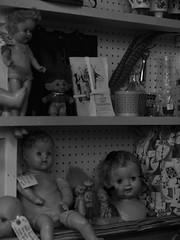 IMG_1013 (asherwilcox) Tags: photography bnw bw blackandwhite bandw spooky antiques contrast dslr old retro vintage architecture buildings doll dolls toys orange colors blue raisins strange esoteric ubuquitous light dark kansascity city film