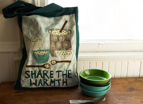 share the warmth green bag