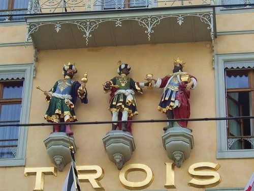 statues of three kings on facade of hotel in Basel