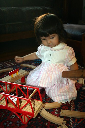 Playing with a train set at the Button's house