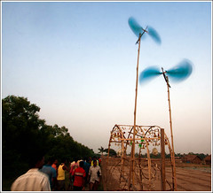 A festive wind [..Dublar Char, Sundarbans, Bangladesh..] (Catch the dream) Tags: people motion windmill festival walking island fan moving gate wind crowd decoration rotation bangladesh fishingvillage windenergy religiousfestival sundarbans rashmela dublarchar hinducommunity dublaisland unidirectionalmotion directionalmotion rashfestival gettyimagesbangladeshq2
