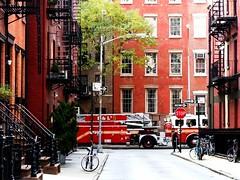 Fire engine in the Village (pilechko) Tags: nyc red ny newyork motion brick iron manhattan bikes streetscene balconies georgian fireengine stoop greenwichvillage wrought hccity