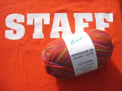 Orange traffic cone shirt and yarn