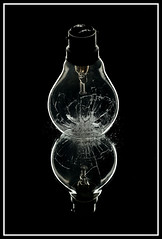 The clash of ideas (Gerald Verdouw) Tags: glass lightbulb smash nikon splinter incandescent dropped d300 rimlight strobist sb900